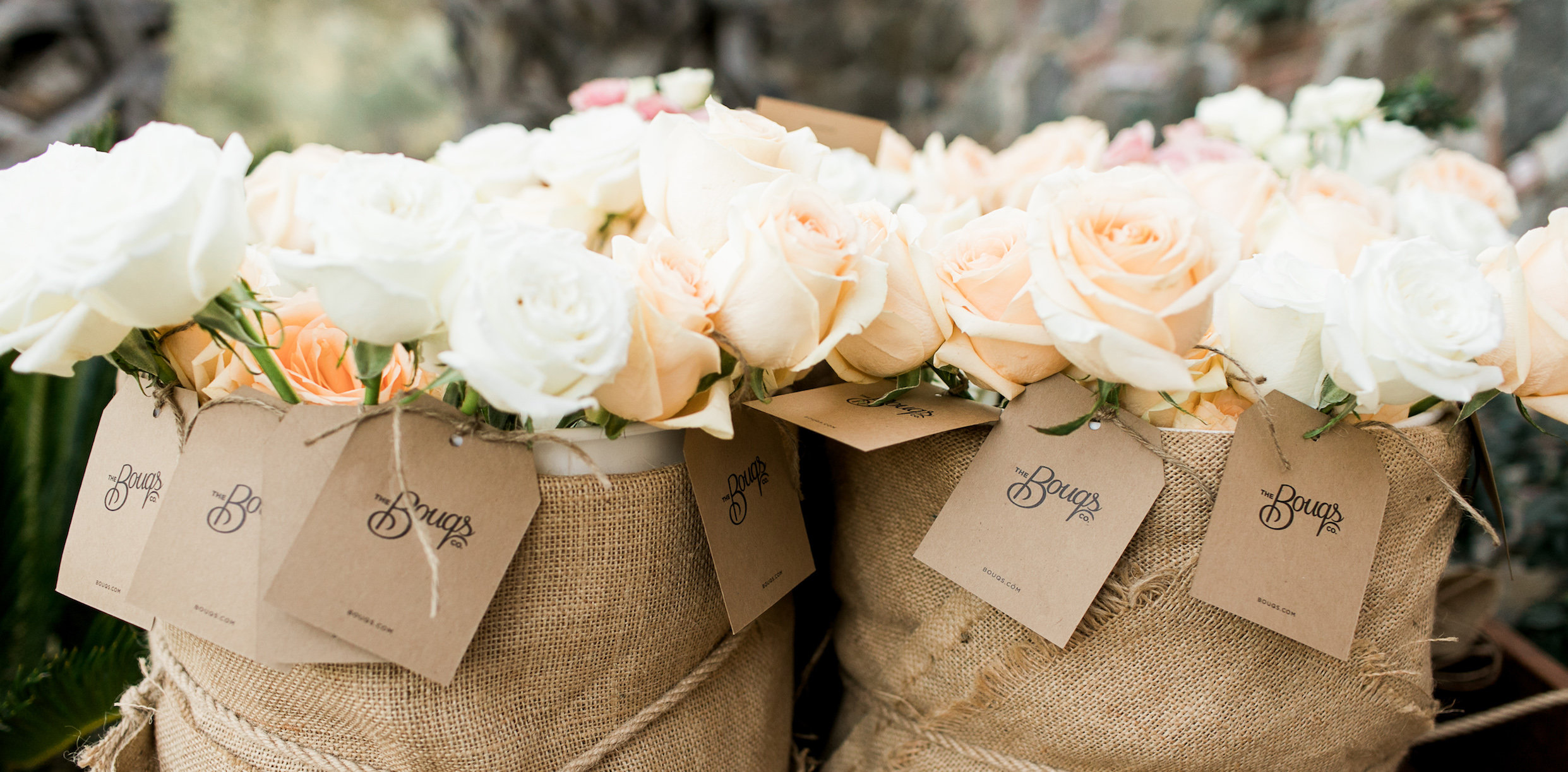 White And Peach Roses In Burlap Sacks