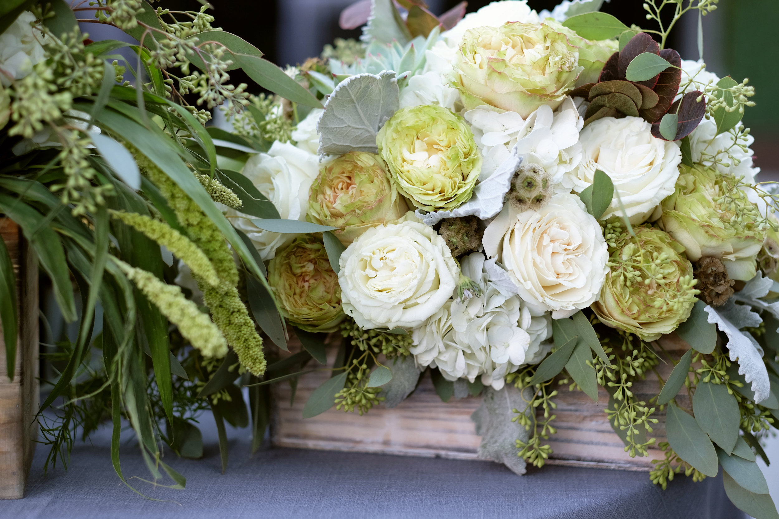 Green and White Garden Roses in Rustic Wooden Box