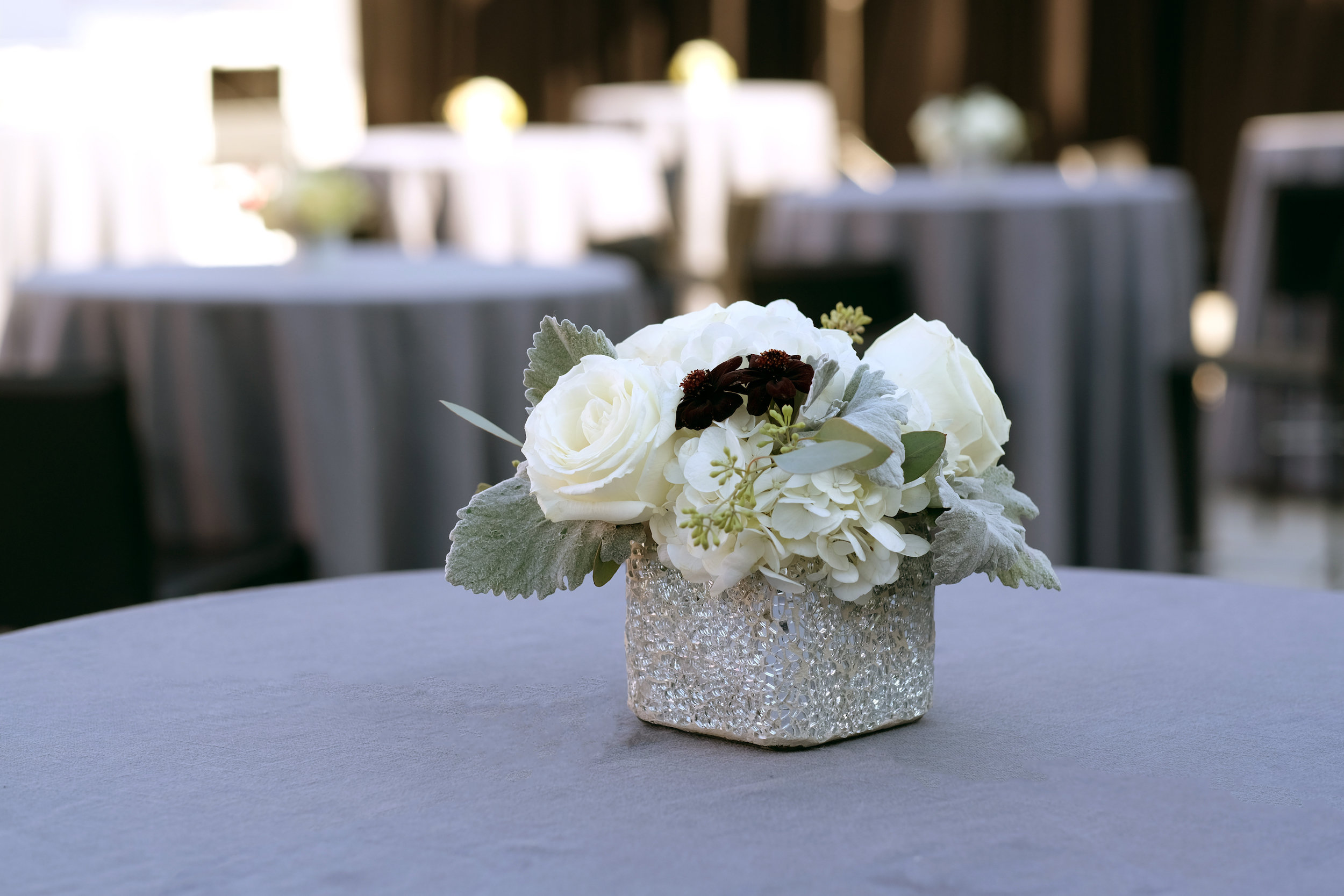 White Floral Centerpiece With Hints of Burgundy