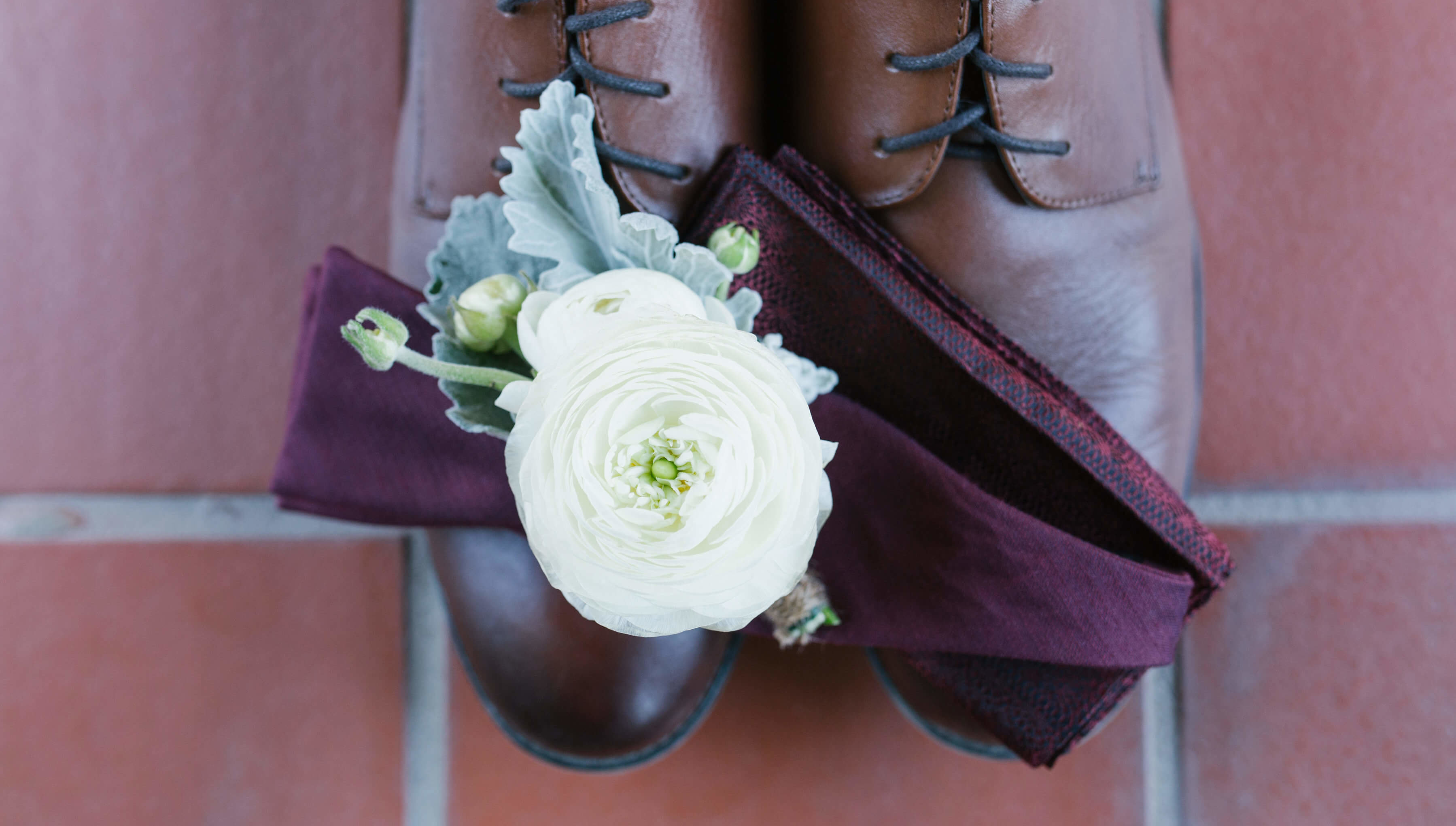 White Peony Boutonniere On Grooms Shoes