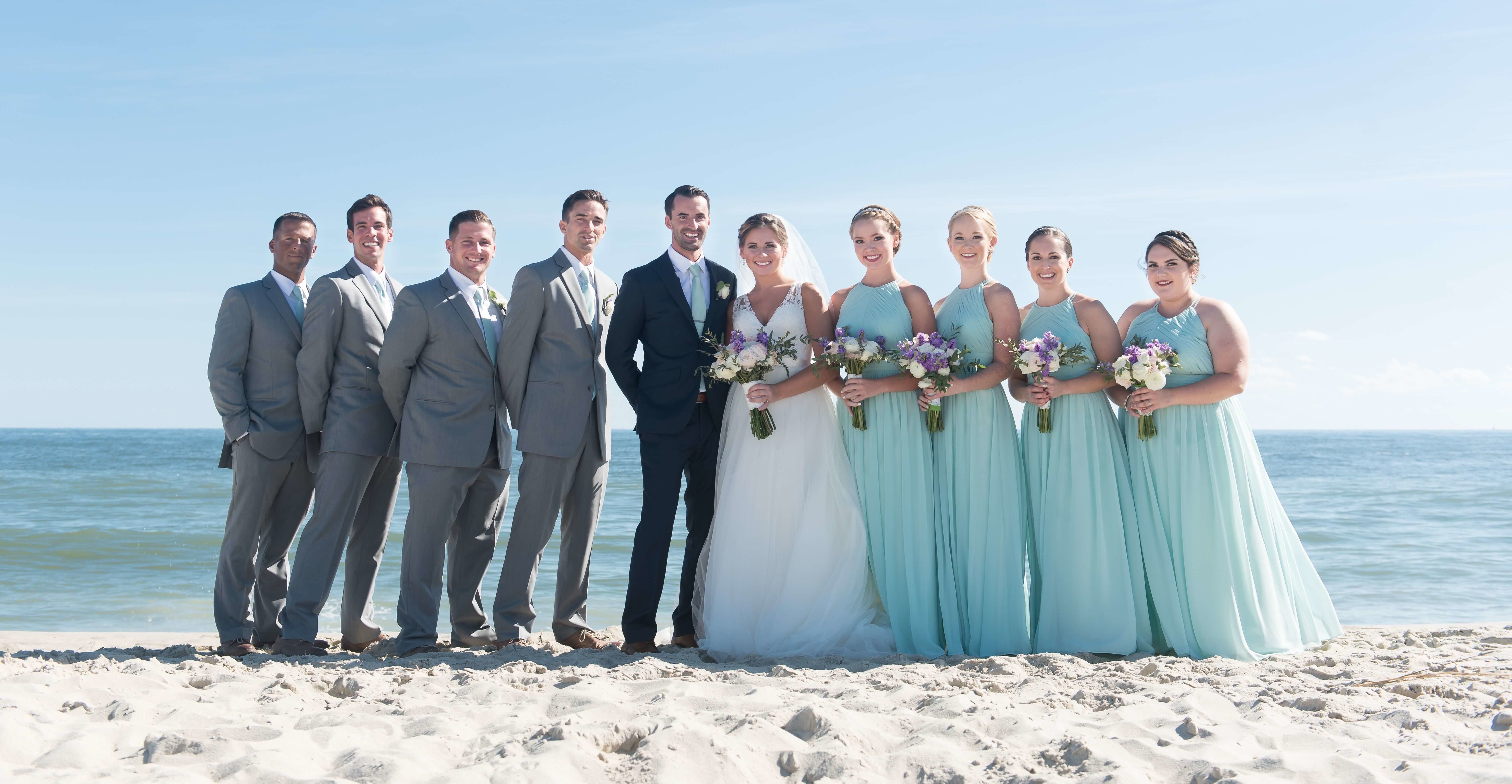 Wedding Party On The Beach With White Roses