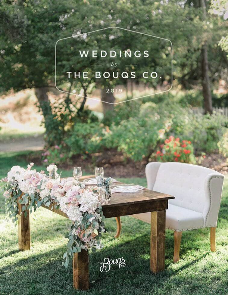 Bride and Grooms Table Covered in Flowers