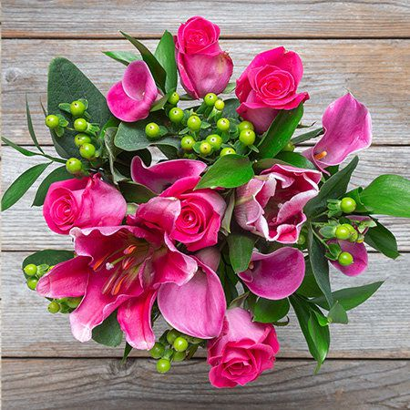 Pink Roses and Lilies with Green Berries