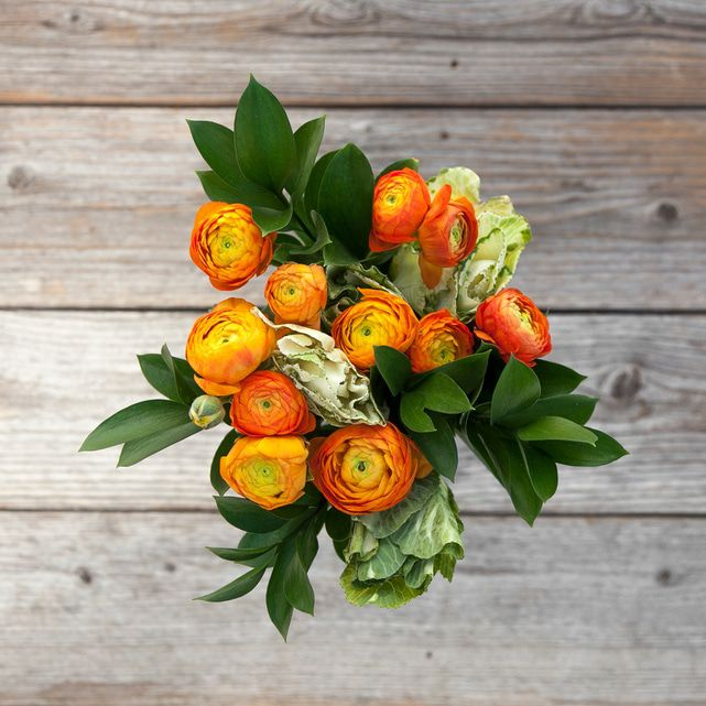 orange ranunculus and kale floral arrangement 3
