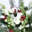 white tulips and snapdragons with red berry and pine accents 7