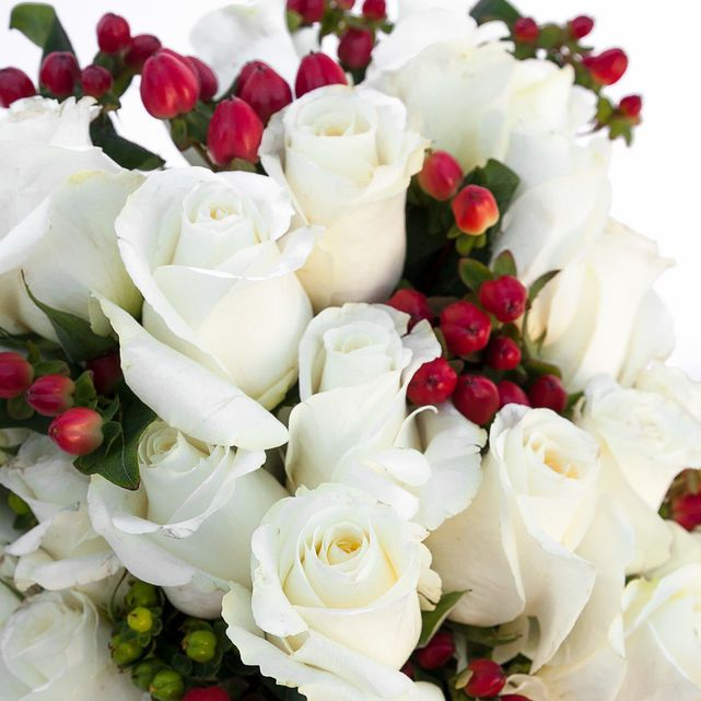 White Roses with Red and Green Hypericum Berry Accents 7